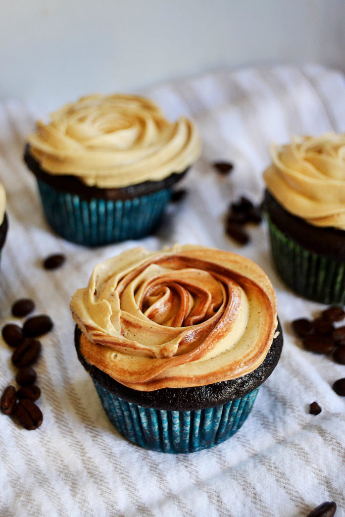 three mocha cupcakes with coffee buttercream